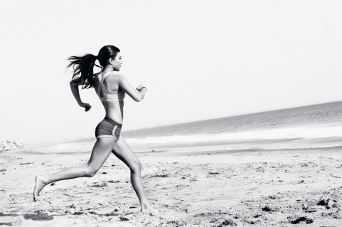 Kourtney Kardashian running outside